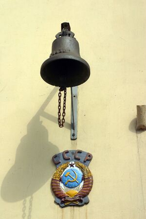 MAY 28, 2009, SYKTYVKAR, RUSSIA - Bell and state symbol of USSR, Syktyvkar ralway station