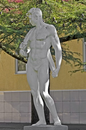 FEB 9, 2016, SOCHI, RUSSIA - Sculpture of the young athletic man in Matsesta, suburb of Sochi Editorial