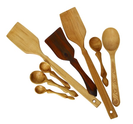 Wooden shovels and spoons on a white background