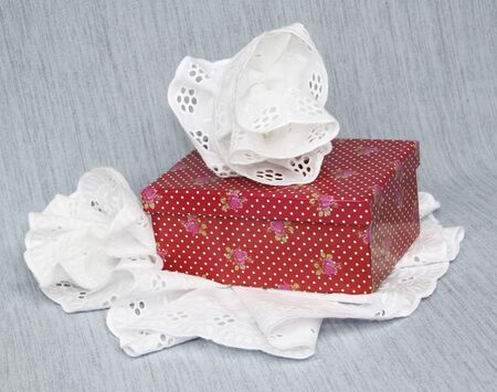 A gift in a box decorated with a flower from laces