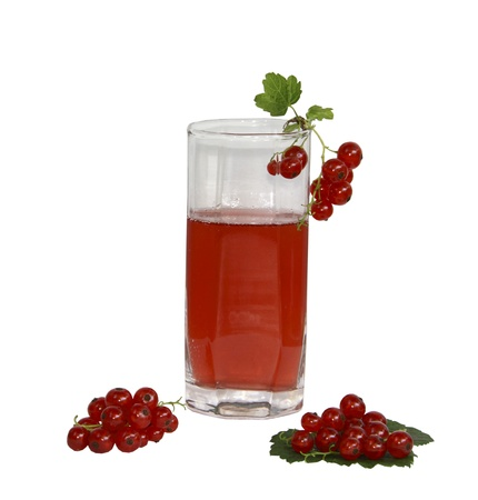 A glass with juice and a red currant on a white background  Stock Photo