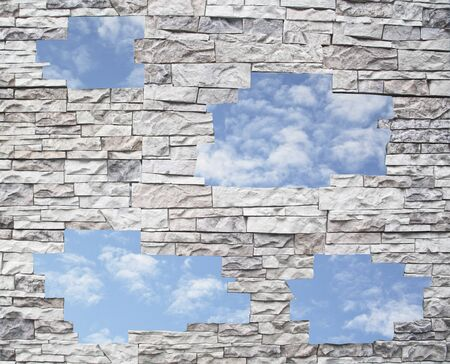 A stone wall with the blue sky in windows  photo