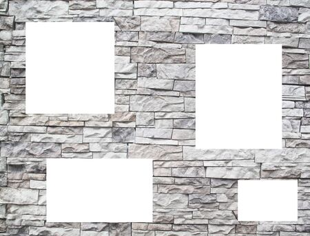A stone wall with white windows