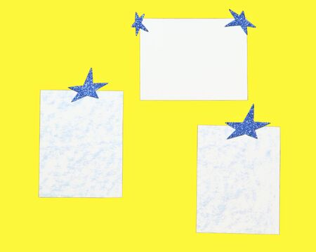 Sheets of paper with dark blue stars on a yellow background photo