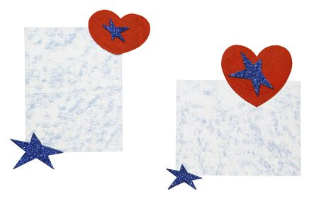 Sheets of paper with hearts and dark blue stars on a white background photo
