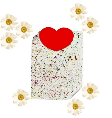 A sheet of paper with a heart and camomiles on a white background  photo
