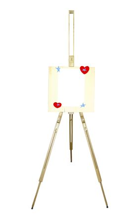 A wooden easel with a sheet of paper, hearts and stars on a white background photo