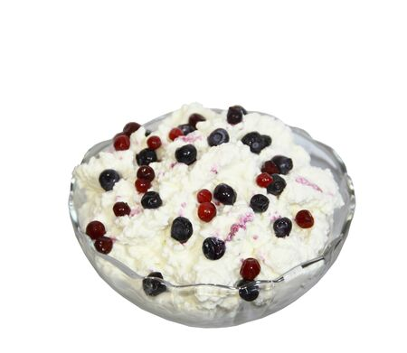 chese: Cottage cheese in a vase is decorated by berries on a white background