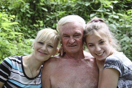 Happy family: grand-dad, daughter and grandchild photo