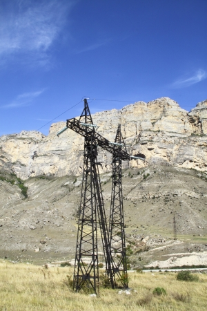 Supports of line of high-voltage transmissions are in mountains