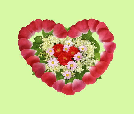 Lovely floral arrangement in the shape of heart from red rose petals  Stock Photo