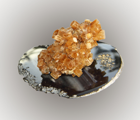 aragonite: Sample aragonite crystals on an agate stone pedestal, a collection of minerals. Stock Photo