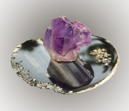 Sample amethyst crystal stone agate on base, a collection of minerals Stock Photo