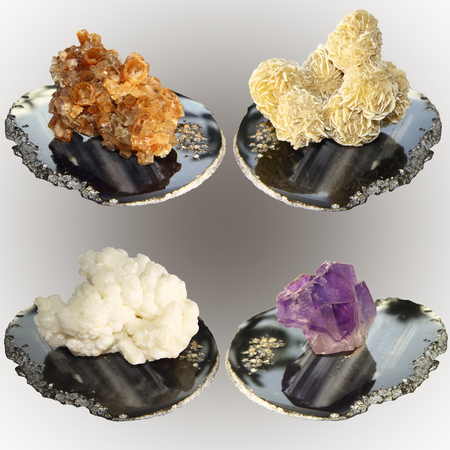 aragonite: Collection of samples of minerals, aragonite, calcite, amethyst, gypsum rose on agate stone pedestals Stock Photo