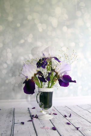 picturesque: Picturesque bouquet with irises and wildflowers on a wooden table