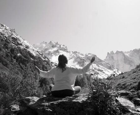 Woman meditating yoga in mountain gorge. Travel. Lifestyle. Relaxation. Emotional concept. Outdoor adventure. Harmony with nature.