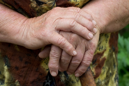 incapacitated: hands of an elderly woman