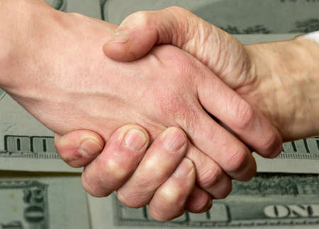 merged: merged two male hands in a handshake