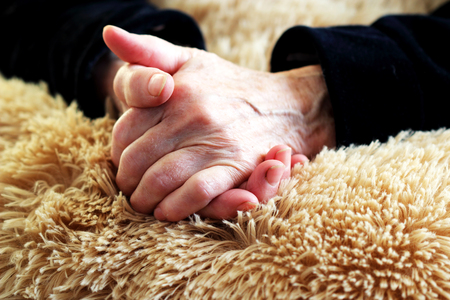 tired female hands on a fluffy pillow