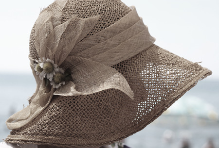 an unknown woman in a straw hat