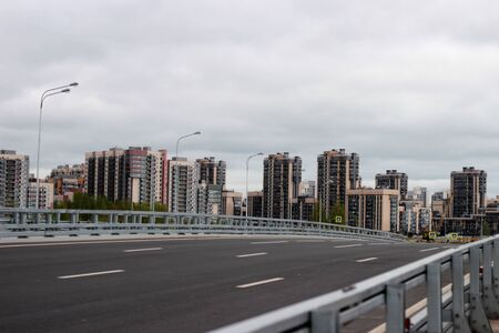 the road to the new young city with beautiful tall buildings