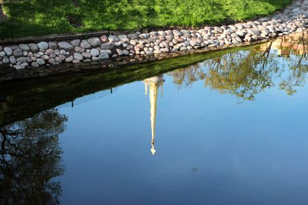 natural spring background with reflection in the lake water