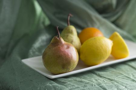 Tasty fruit on a ceramic plate