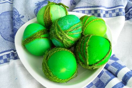 painted easter green eggs on a plate