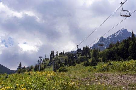 kz: ropeway in mountain Shymbulak under cloudy sky in Kazakhstan, Almaty