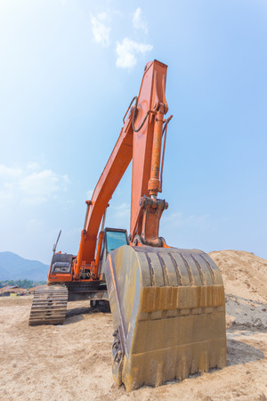 excavator machine at excavation earthmoving work in sand photo