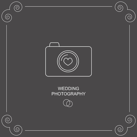 wedding photography: Wedding photography. The image of the camera lens with heart and wedding rings in the box.