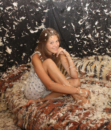 young beautiful girl in the feather photo
