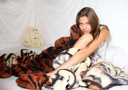 young beatiful girl muffled in the covering with bear photo