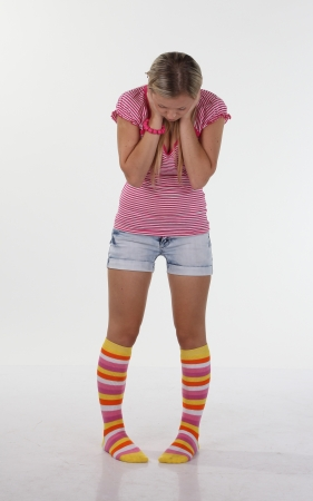 young beautiful woman looking on her socks photo