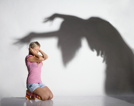 woman shadow:  young beautiful woman frightened by the shadow