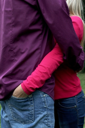 Couple in Love and with yhe hands in the pockets photo