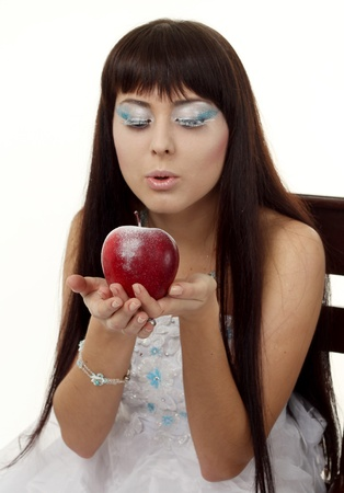 Woman Dressed as Ice Queen with red apple photo