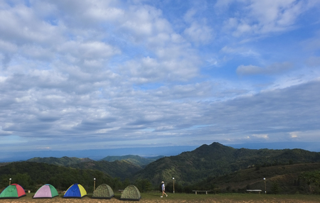red grass: camping, tent, camp, background, nature, home, mountain, forest, yellow, wild, landscape, sport, campsite, outdoors, hiking, summer, beautiful, travel, adventure, autumn, blue, green, beauty, red, grass Stock Photo