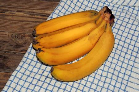 picnic food: Bananas on a wooden picnic table . Stock Photo