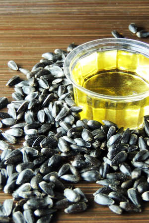 sunflower oil: Sunflower Oil with seeds.  on vintage wooden background Stock Photo