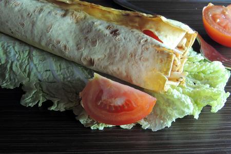 kabob: chicken kabob with salsa and yogurt on a flatbread