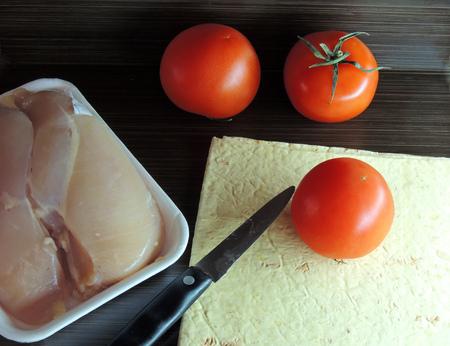 pita bread: Tomato, pita bread and chicken fillet on wooden background Stock Photo