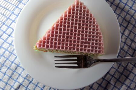 condensed: waffle cake with condensed milk and fruit.