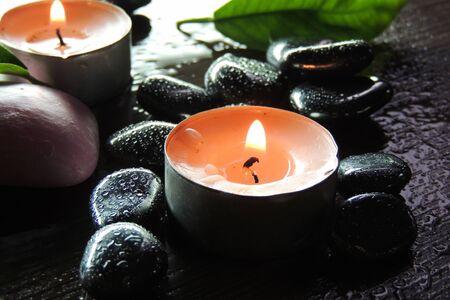 zen candles: Zen stones and aromatic candles on table,Zen concept.