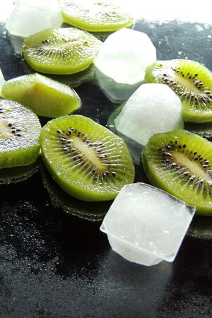 popsicle: Homemade fruit popsicle with kiwi and mint.