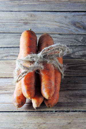 rustical: Fresh Organic Carrots in a basket on wooden background, rustical, selective focus