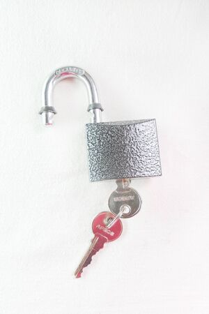 lock and key: Old master key rusty and key lock on white background