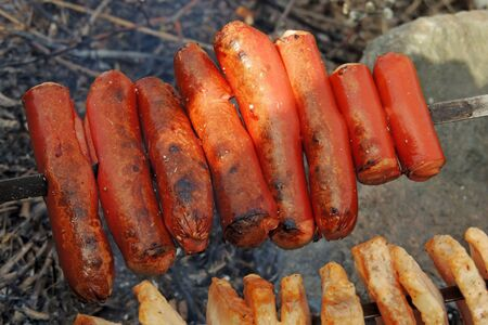broiling: grilled sausage on a barbecue grill, thai food Stock Photo