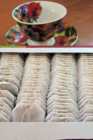 nontraditional: Tea bags, tea and Jasmine on a wooden table