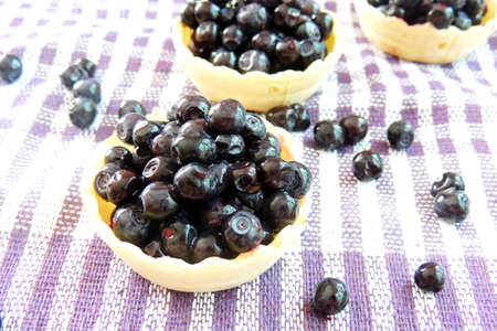diet product: ripe blueberries in a waffle basket on an old wooden background. rustic style. health and diet product. selective focus